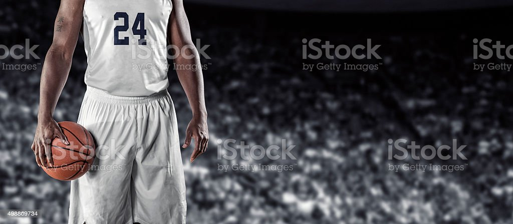 Close up view of Basketball Player on a black background stock photo
