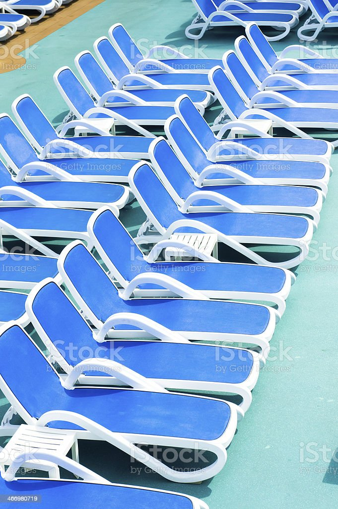 Close up view of blue deck chairs royalty-free stock photo