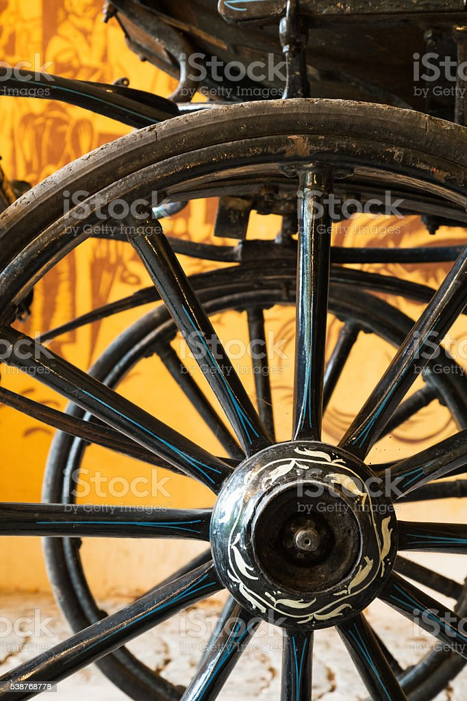 Close up view of carriage wheels with long spokes stock photo