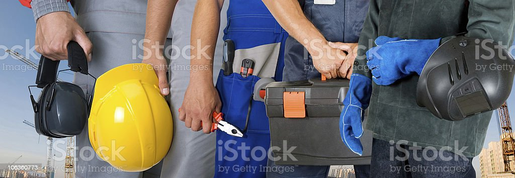 Close up view of different workers hands holding tools royalty-free stock photo