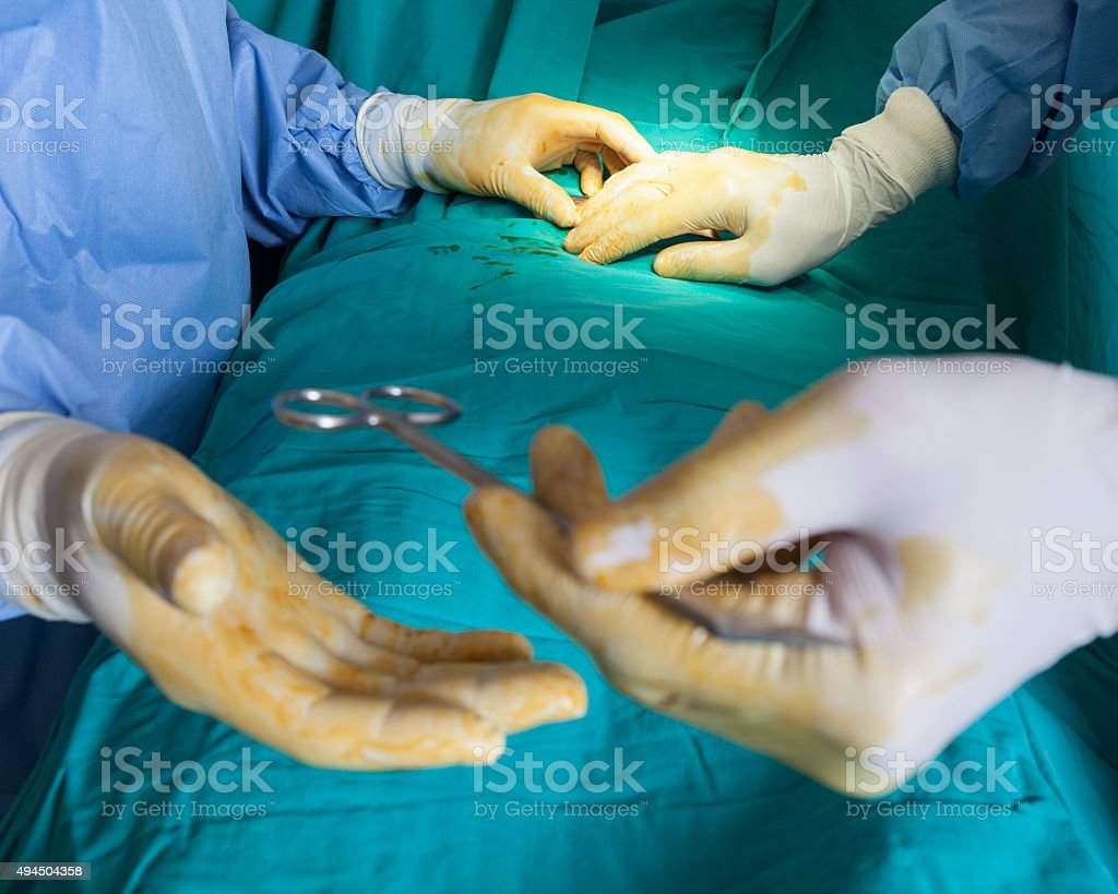 Close up view of doctors making surgery stock photo