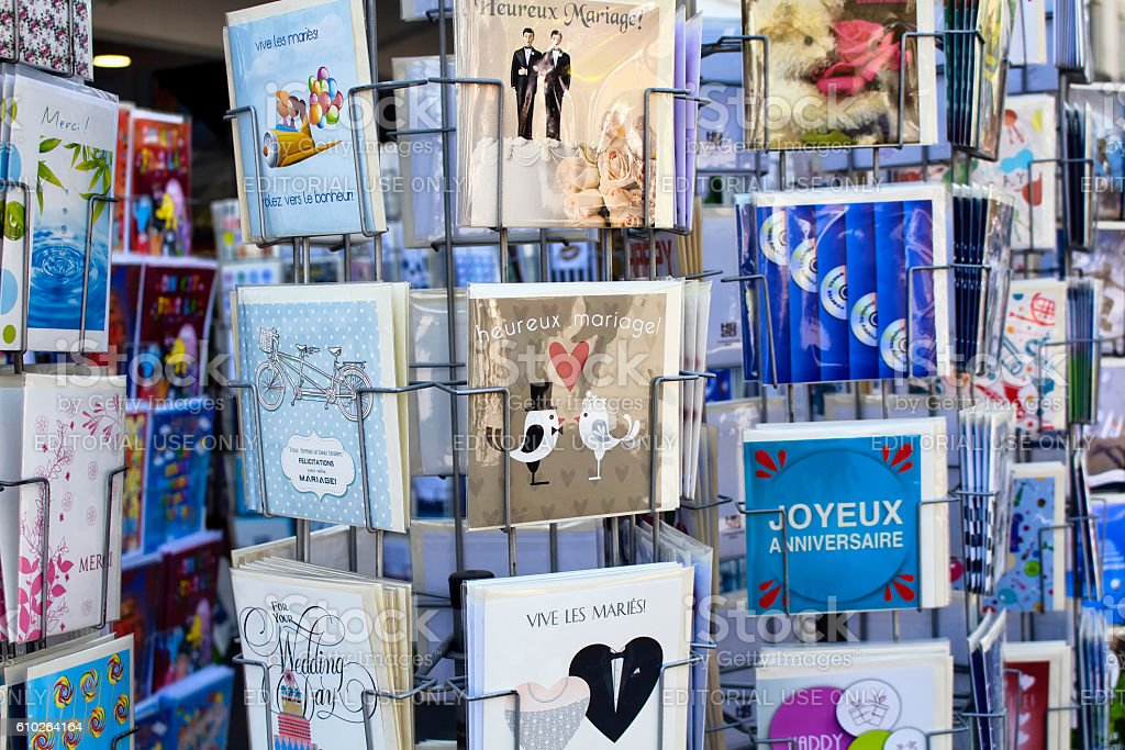 Close up view of French postcards on racks about marriages stock photo