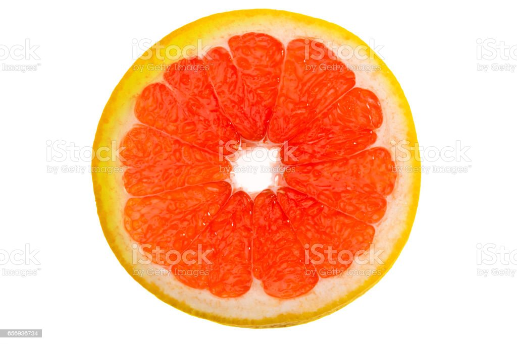 close up view of fresh grapefruit slice on white stock photo