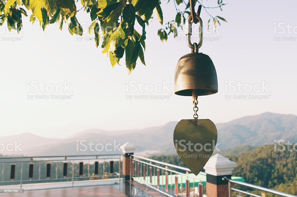 Close up view of golden bell in temple with mountain stock photo