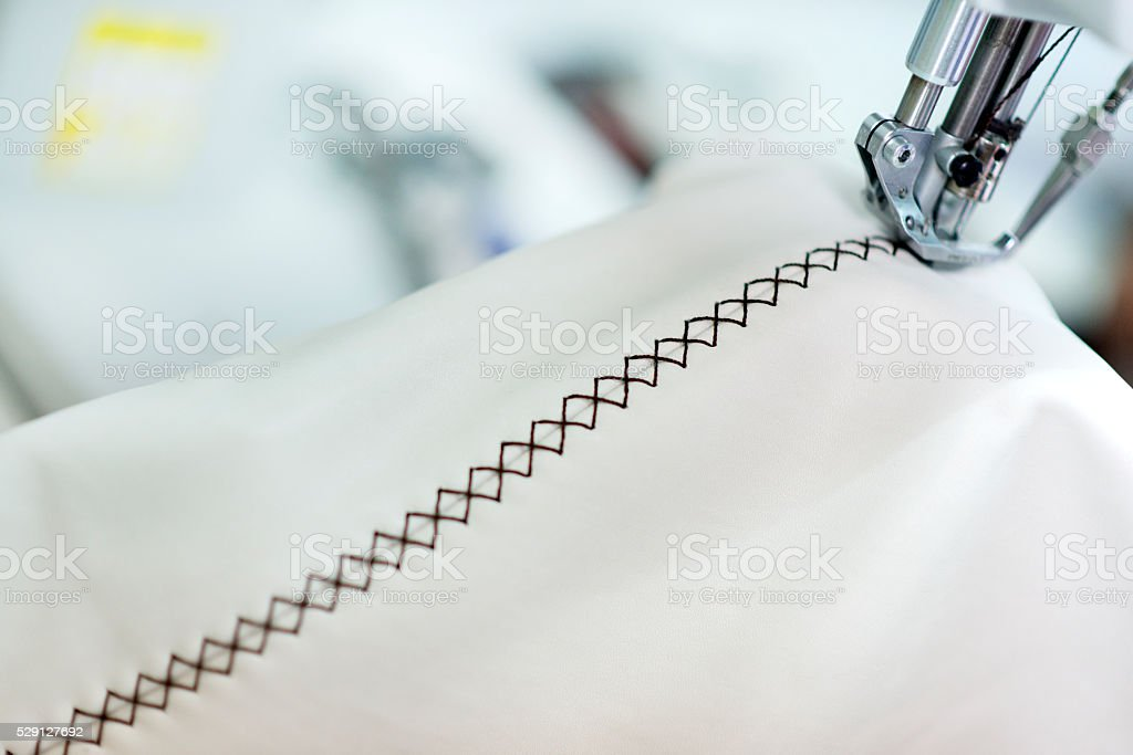Close up View of Industrial Sewing Machine with Presser Foot stock photo
