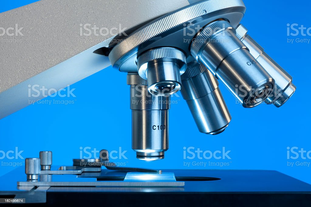 Close up view of microscope lenses looking at a slide  stock photo