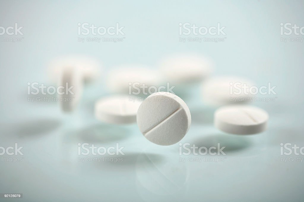 Close up view of pile of white pills  royalty-free stock photo