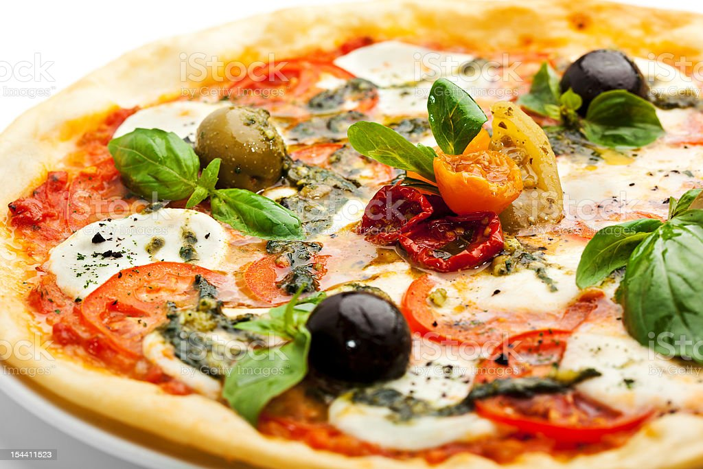 Close up view of pizza with fresh basil and olives royalty-free stock photo