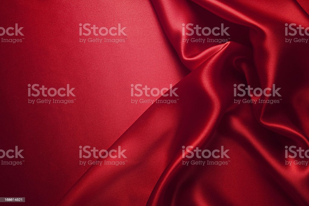 Close up view of red silk clothing piece and red background stock photo