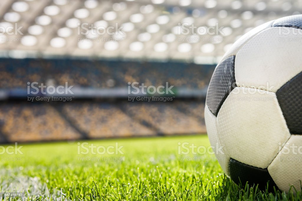 close up view of soccer ball on grass on soccer field stadium stock photo