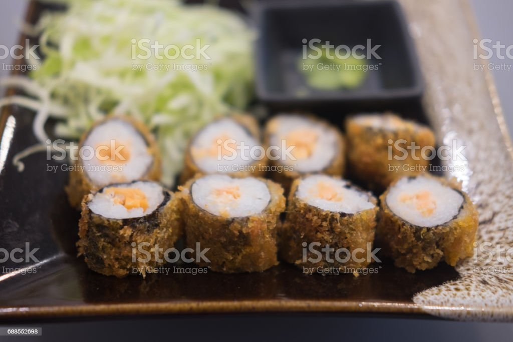 Close up view of sushi roll with salmon in a beautiful plate stock photo