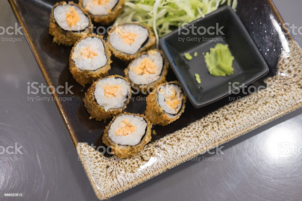 Close up view of sushi roll with salmon, top view stock photo