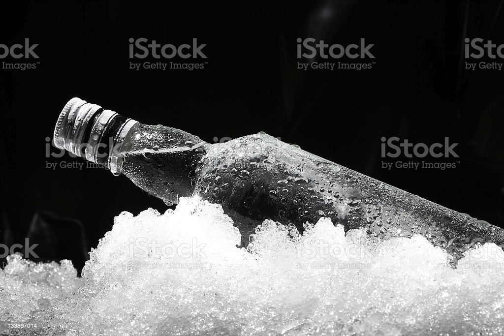 Close up view of the bottle in ice stock photo