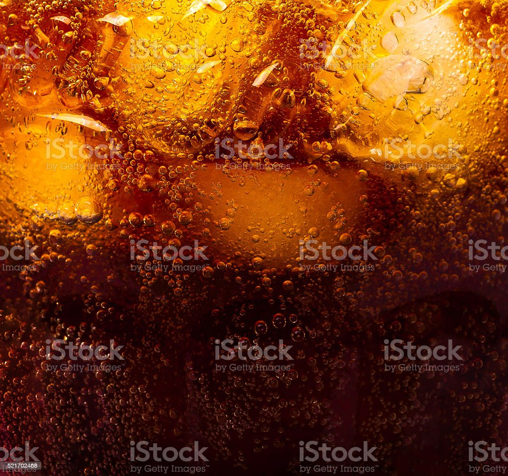 Close up view of the ice cubes in cola background stock photo