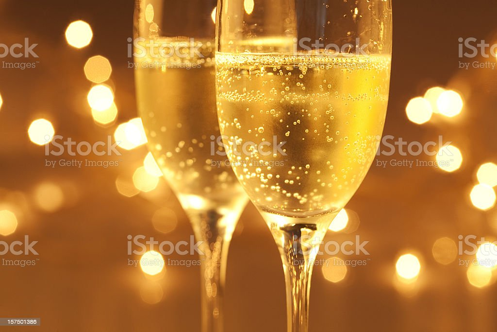 Close up view of two sparkling champagne glasses royalty-free stock photo