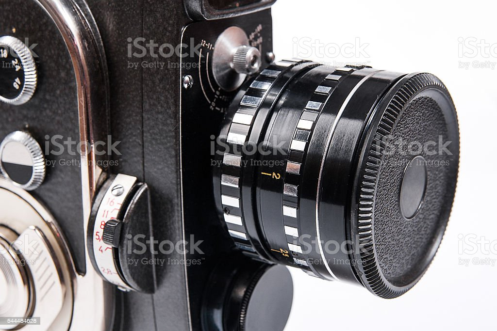 Close up view of vintage movie camera isolated on white stock photo