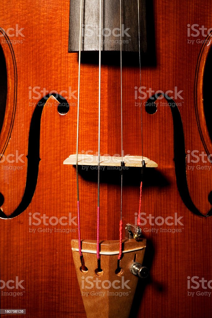 Close up view of violin showing the grain of the wood  stock photo
