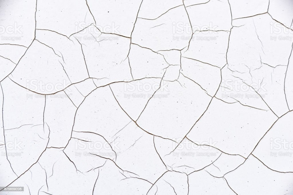 Close up view of white and thick cracked paint on an old traffic signpost. stock photo