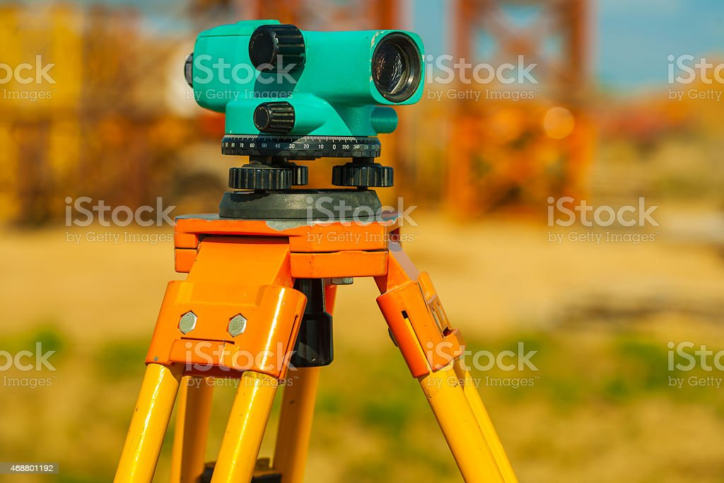 close up view old theodolite on construction place stock photo
