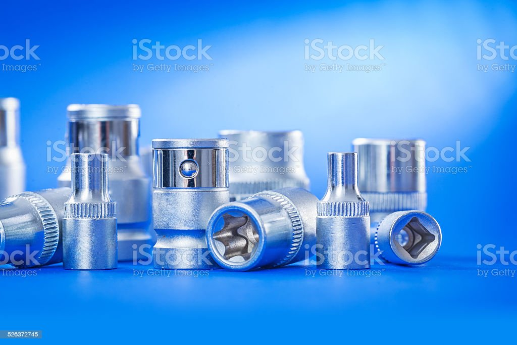 close up view on automobile torx on blue background stock photo