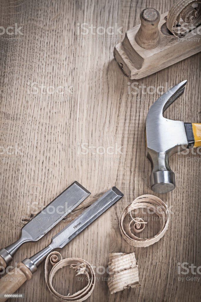 close up view on hammer chisels and planner shavings stock photo