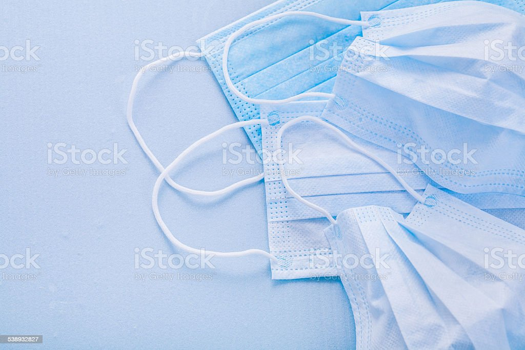 close up view on medical surgical flu ilness protective face stock photo