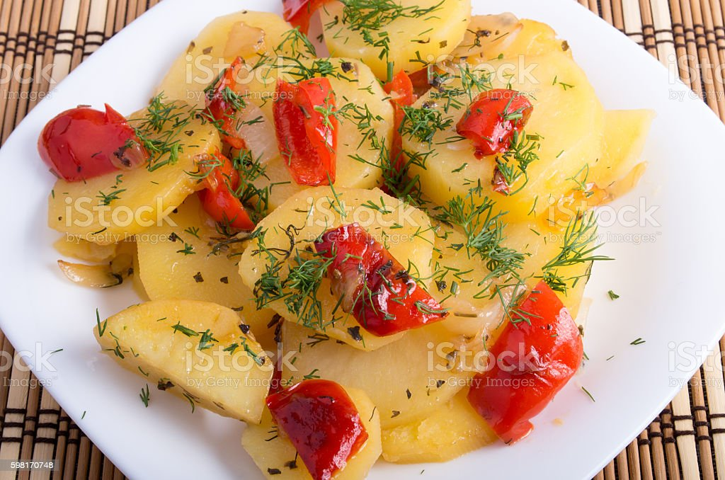 Close up view on vegetarian dish with slices of potatoes stock photo