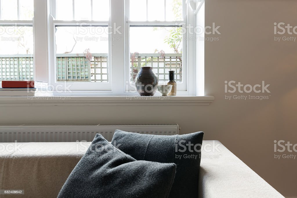 Close up vignette of cushions and window objects in apartment stock photo