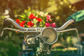 close up vintage bicycle with bouquet flowers in basket