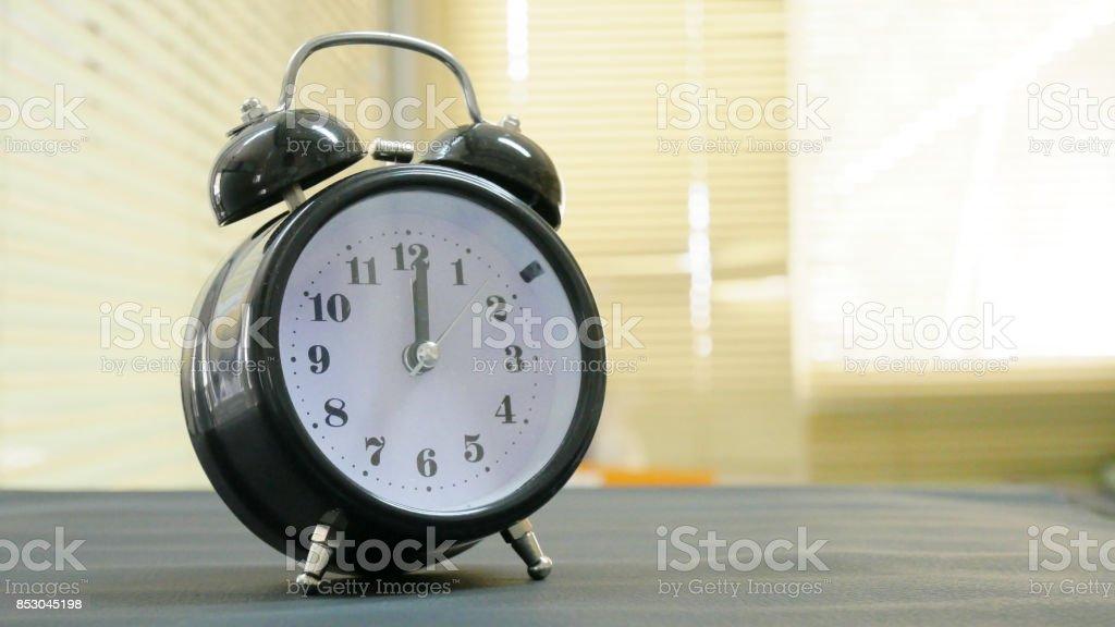 Close up vintage clock on blur background. stock photo