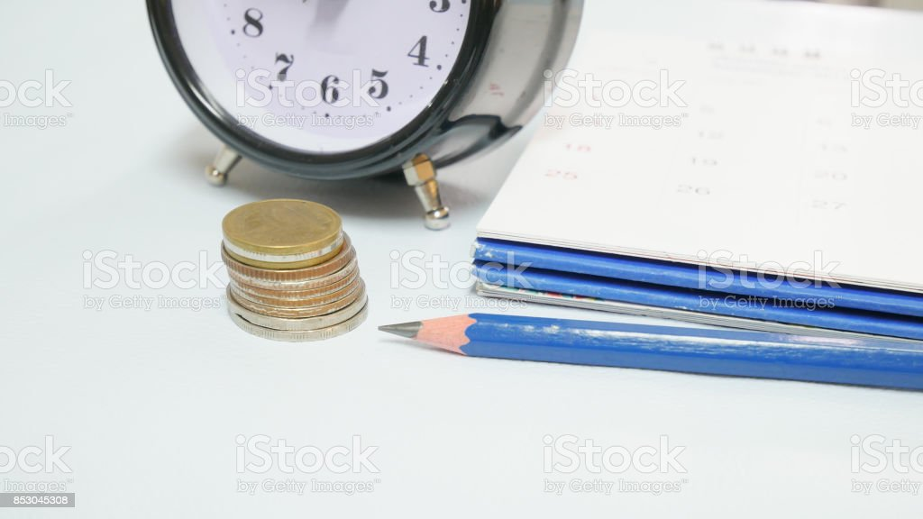 Close up vintage clock with calendar.planning concept. stock photo