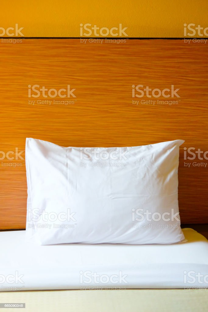 Close up white bedding sheets and pillow in home
