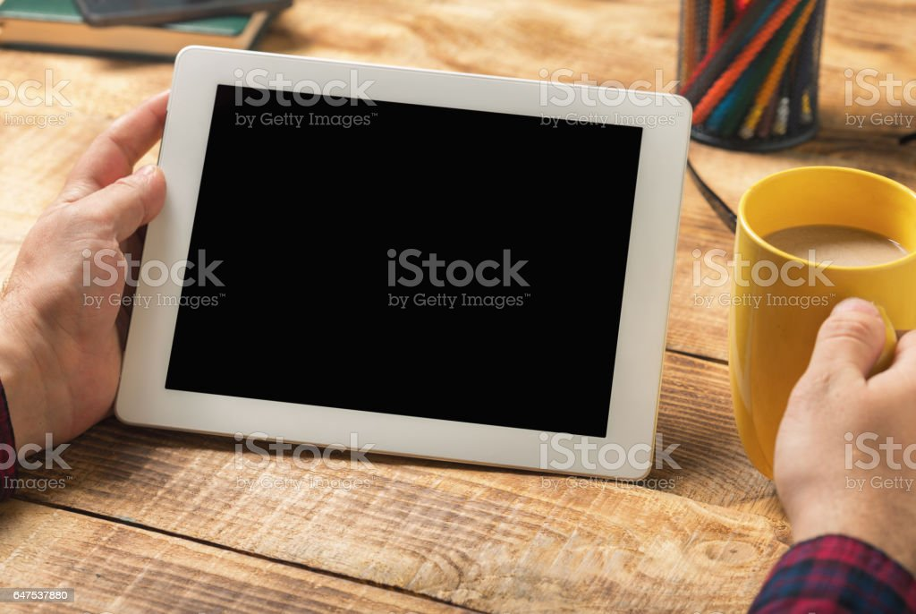 Close up white tablet with copy space in male hands stock photo