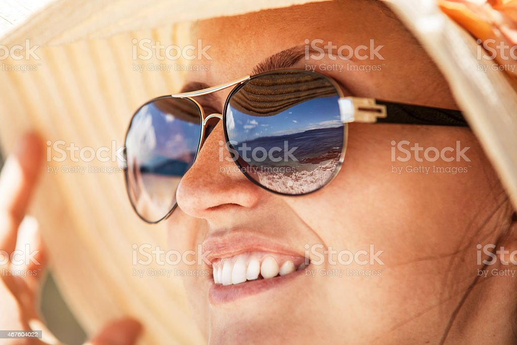 Close up woman portrait in big summer hat stock photo