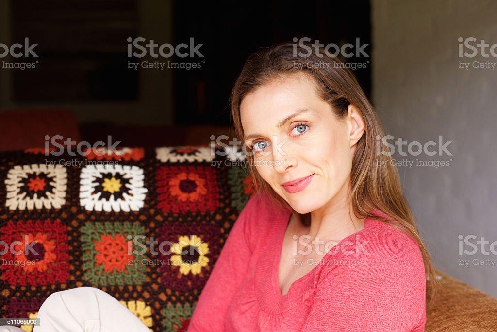 Close up woman relaxing at home looking at camera stock photo