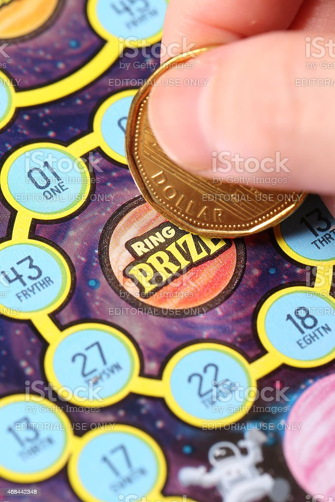 Close up woman scratching lottery tickets. stock photo