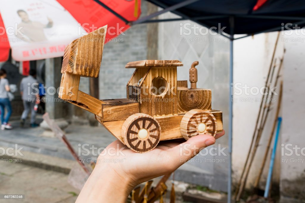 close up wooden backhoe model holding on hand stock photo