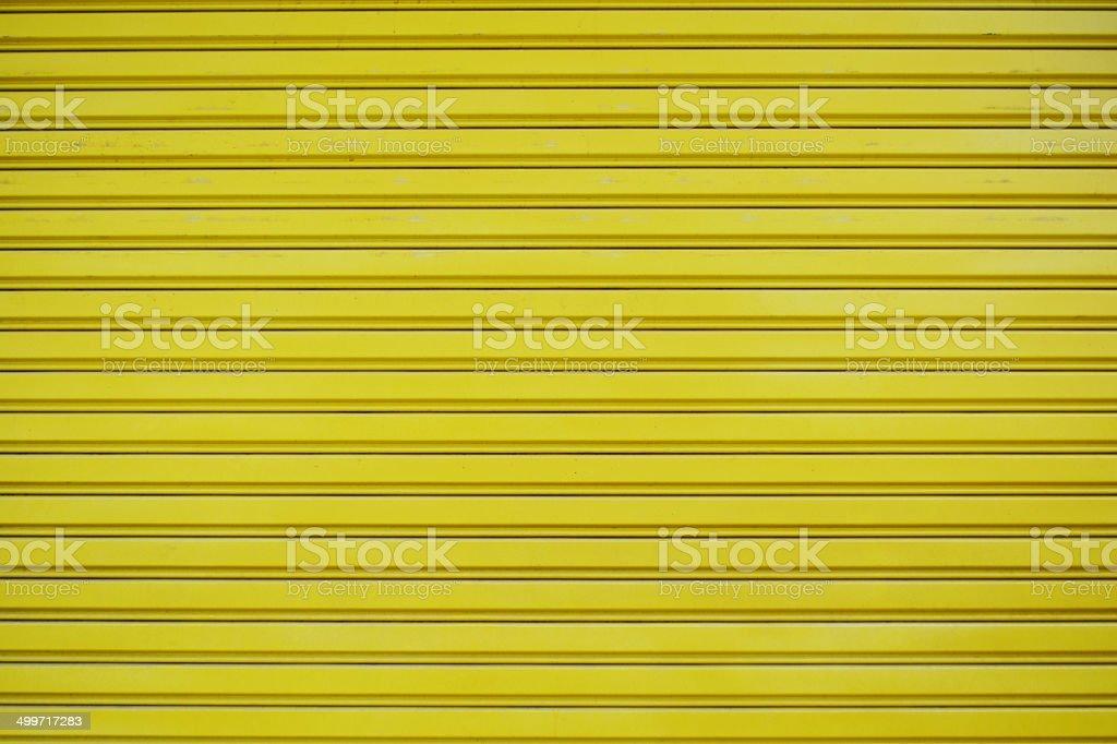 Close up yellow metal sheet slide door texture background. stock photo