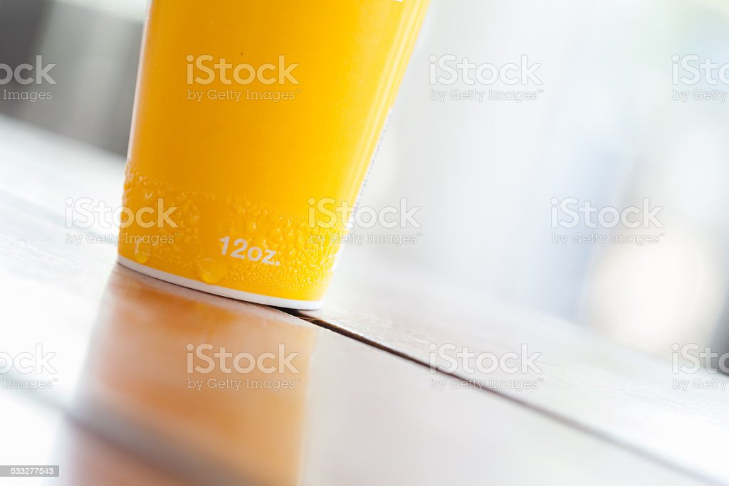 close up yellow paper cup stock photo