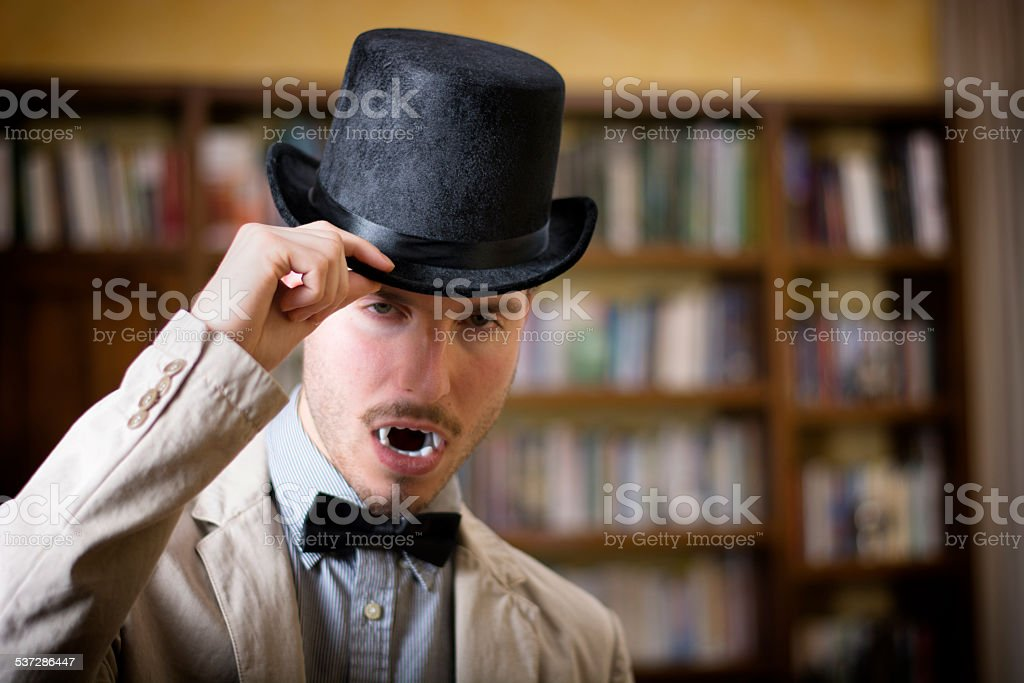 Close up Young Vampire with Black Top Hat stock photo