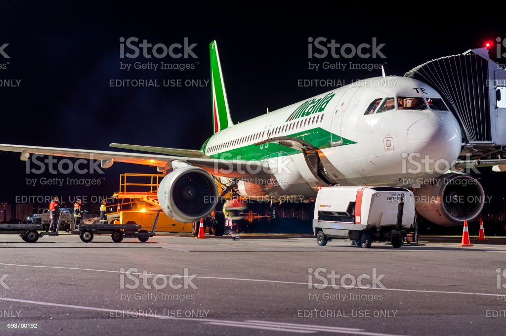 KIEV, UKRAINE - MAY 2: Close view of Alitalia aircraft fuselage near the entering baggage door, at night. May 2, 2017. stock photo