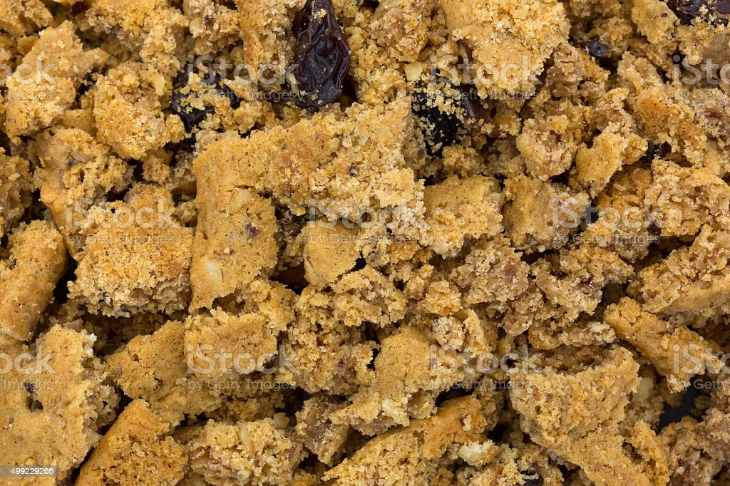 Close view of crumbled oatmeal raisin cookies stock photo