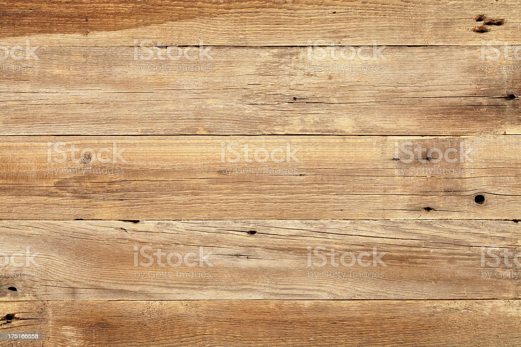 Close view of wooden plank table stock photo