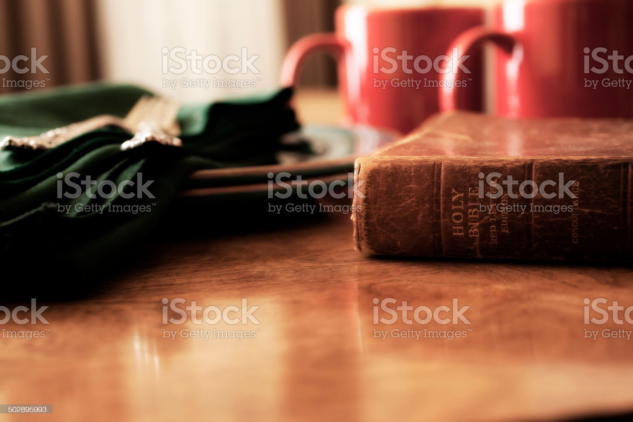 Closed Bible and morning coffee cups on breakfast table. royalty-free stock photo