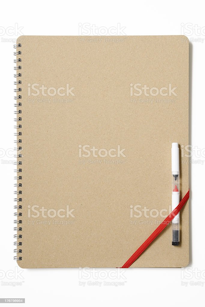 Closed blank spiral notebook like a whiteboard with felt pen royalty-free stock photo