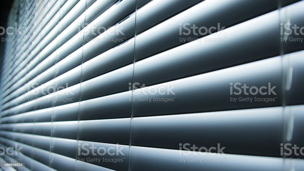 closed blinds blue stock photo