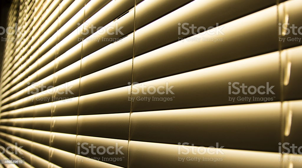 closed blinds yellow stock photo