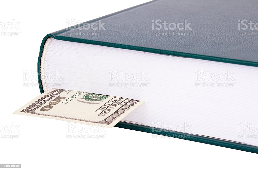 Closed book with a bookmark USD 100 on the right royalty-free stock photo