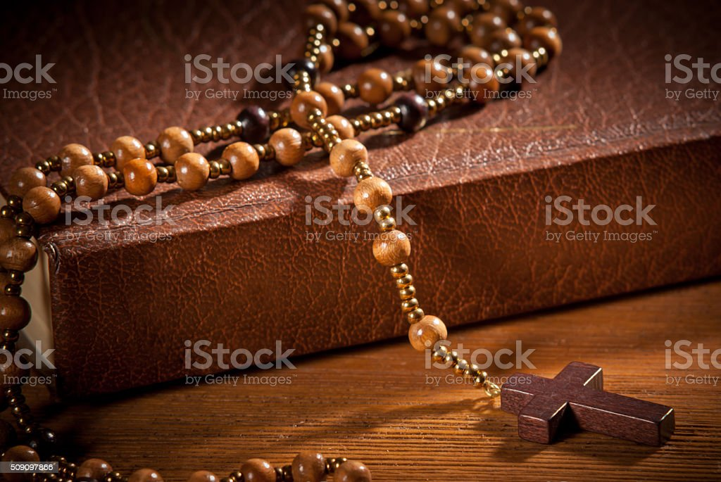 closed book with rosary stock photo
