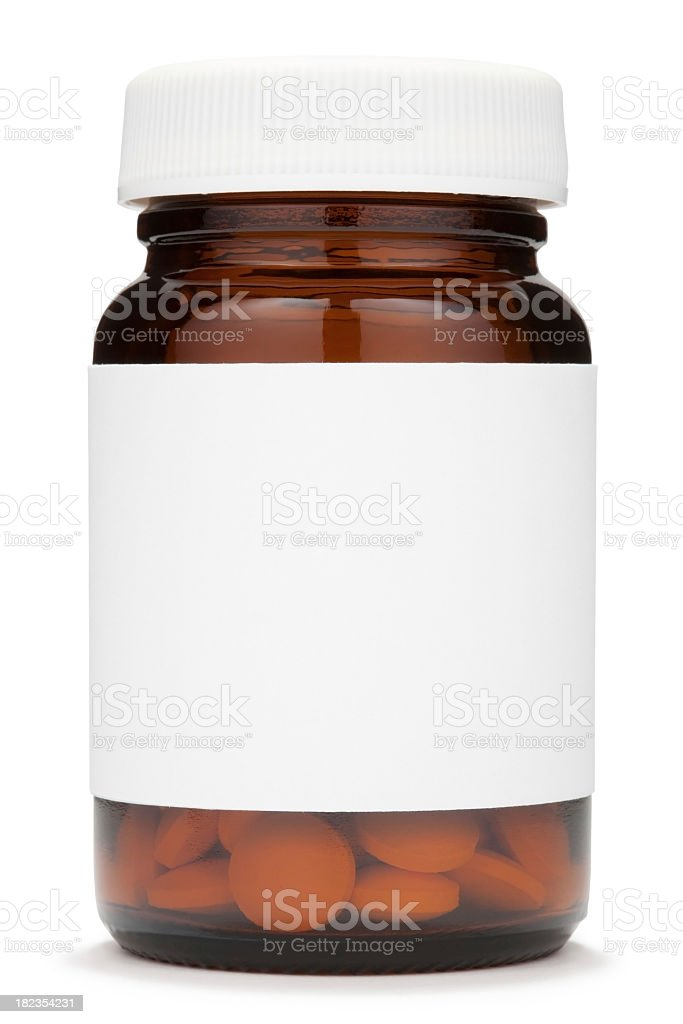 Closed brown glass jar with a blank label containing pills stock photo